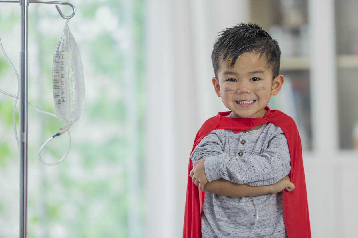 boy-with-cape-and-iv-drip