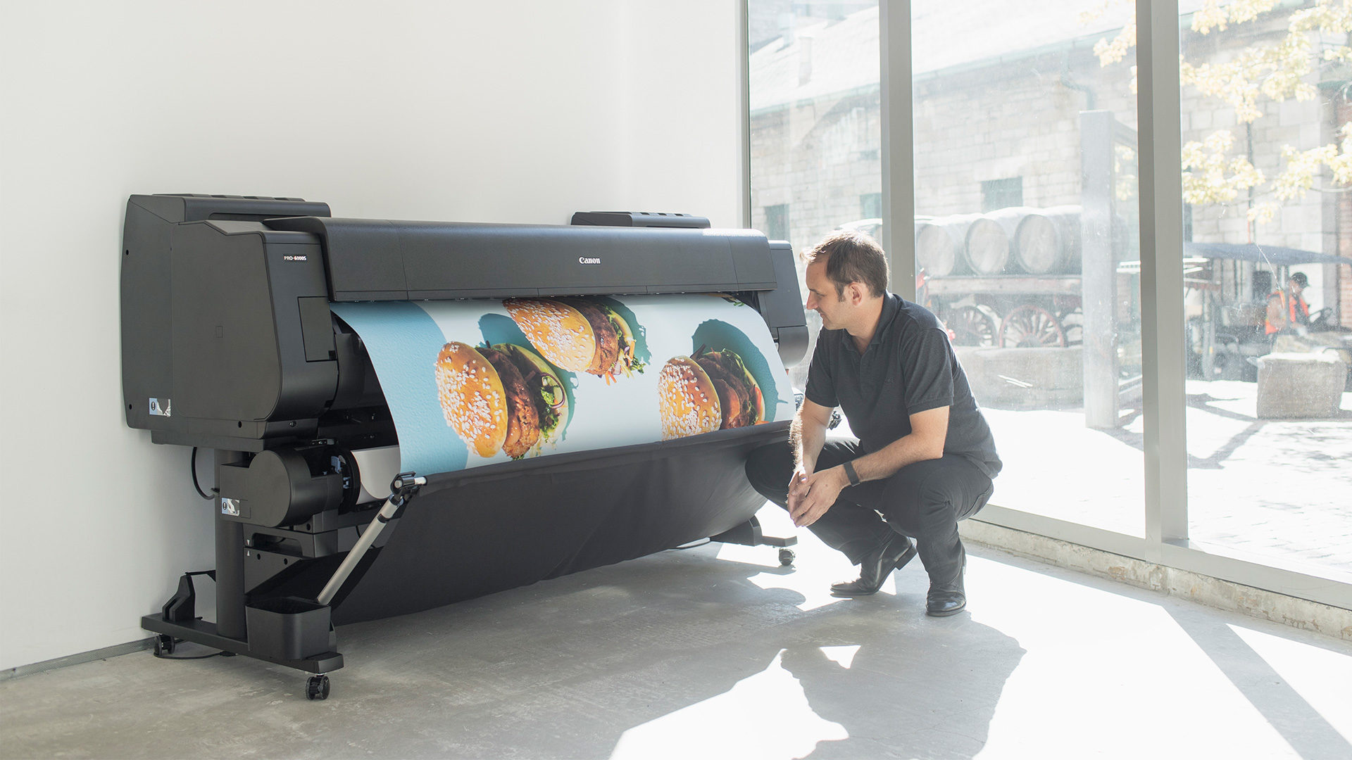 man-printing-on-canon-wide-format-printer
